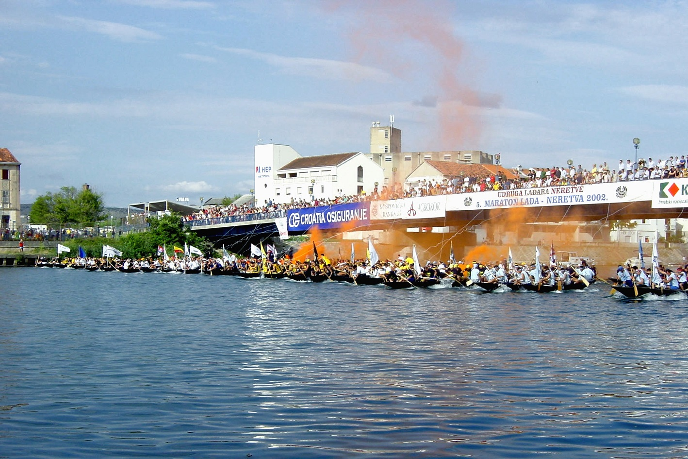 Festive scene of boats preparing for race